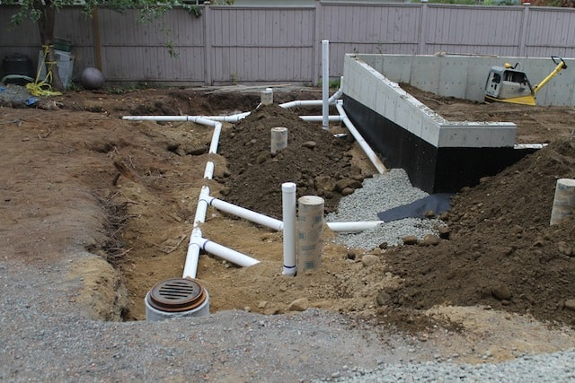 Plumbing has bee roughed in for the building. Rain downspout leaders, and weeping tile are in place and connected to the municipal sewer.